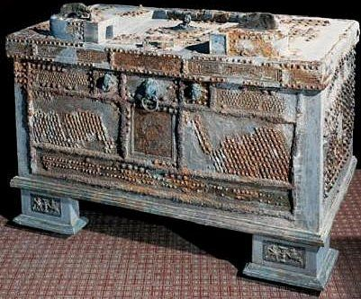 """Image 2 A strongbox found in the Villa of L. Crassius Tertius, Oplontis. The strongbox contained over 200 coins together with a collection of gold and silver jewellery- it was found in the peristyle. The wooden framework of the box is covered with iron sheets, and is inscribed """"Pythonymos, Pytheas, and Nikokrates, the workers of Herakleides, made [this]."""" The items of jewellery include a bronze seal ring bearing the inscription L.CRAS.TERT."""