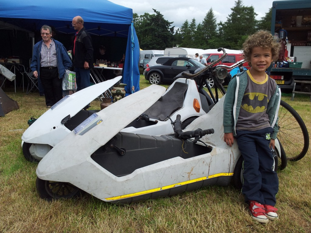 Junior salvage hunter Josh at a vintage fair with 2 Sinclair C5s