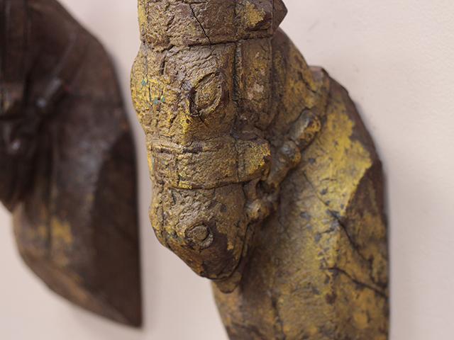 Antique horse head statute
