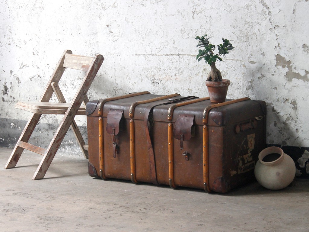 Leather travel trunk used as a storage trunk or trunk coffee table