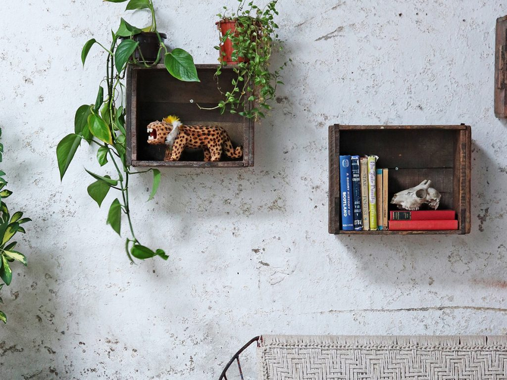 Vintage storage crates as wall shelving