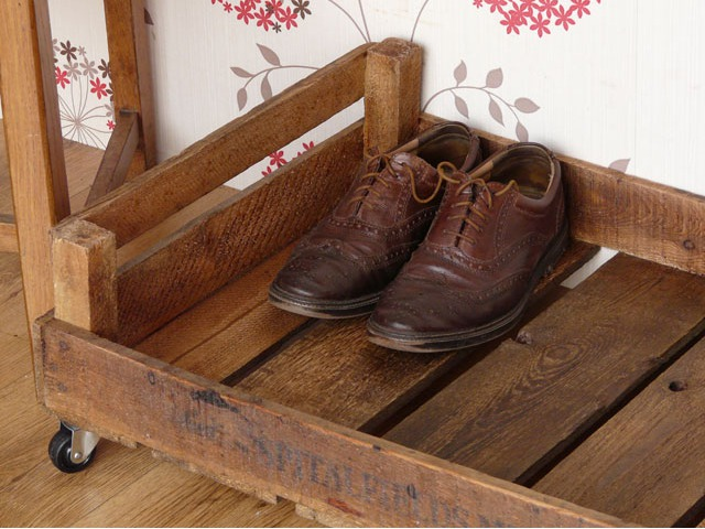 Vintage apple crates as shoe storage