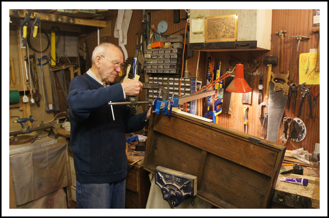 Bill working on an antique wooden chest