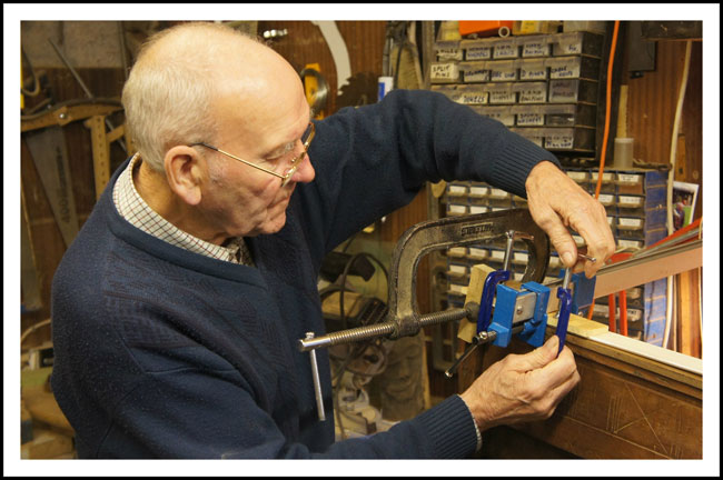 Bill uses five clamps to repair the corner and edge of the chest's lid / top