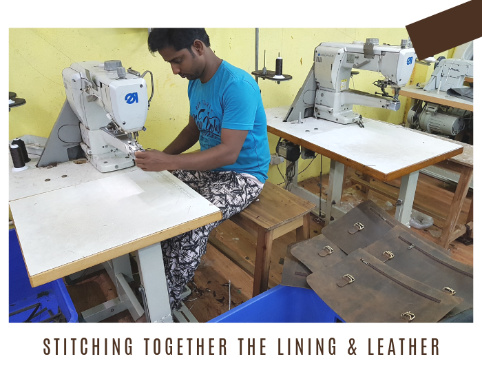 Skilled worker stitching our bags together