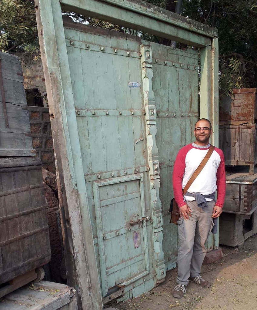 Carl next to a large wooden door. Buying old wooden doors in India