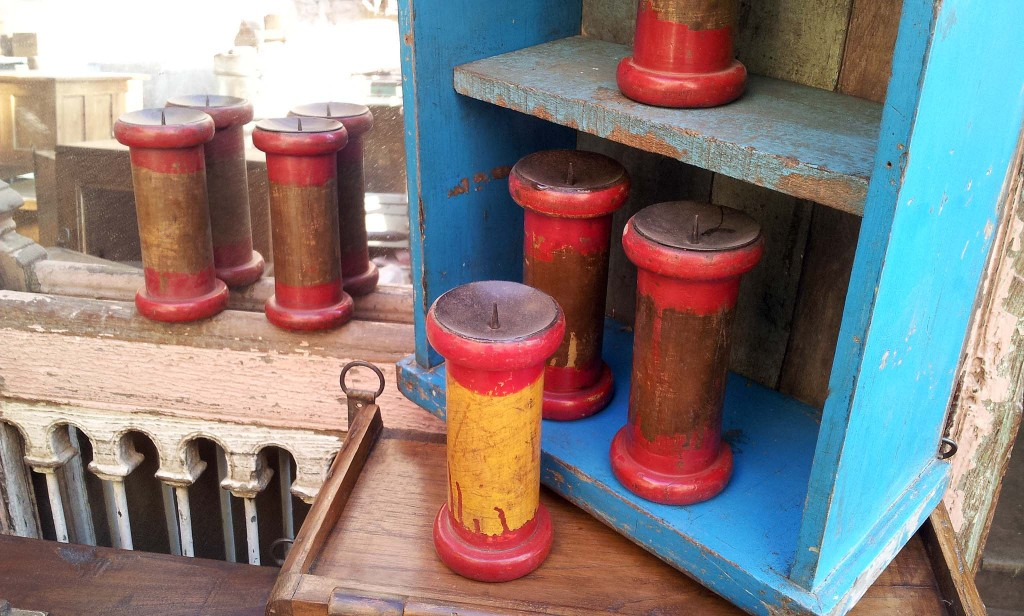 Large old thread bobbins upcycled into candle holders