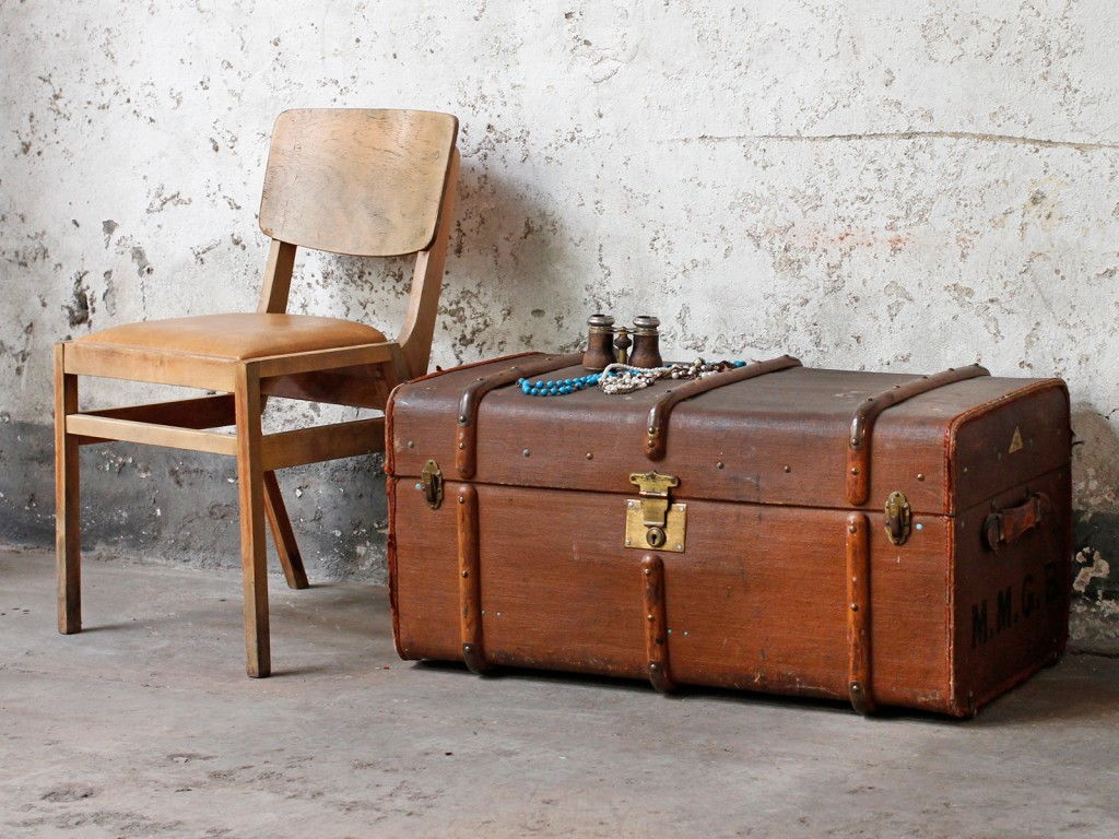 A fibre and wooden travel storage trunk