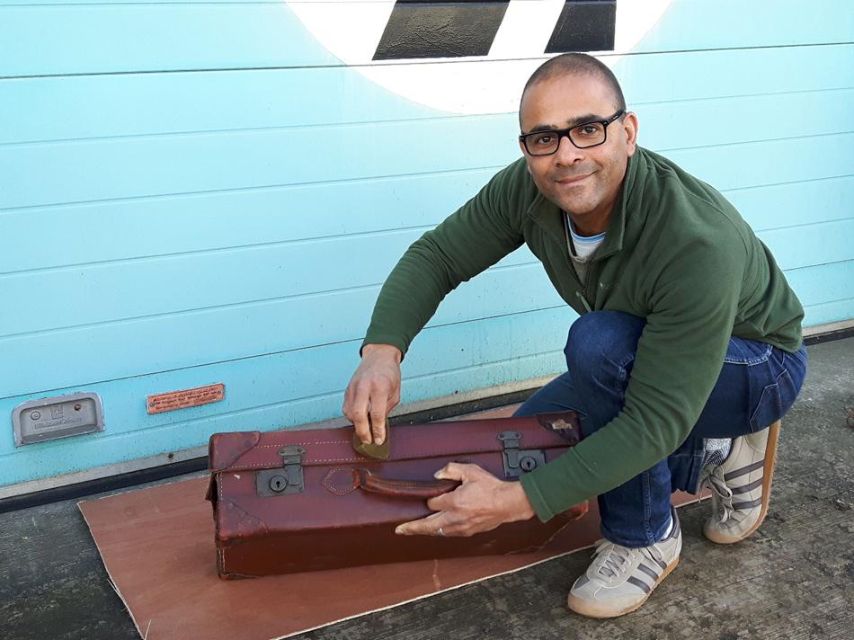 Carl restoring a vintage leather suitcase