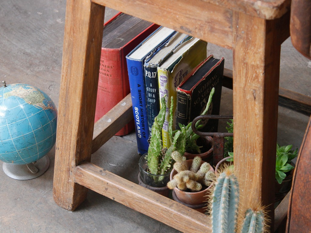 Make use of the space inside the stool to display and store books and decorative items