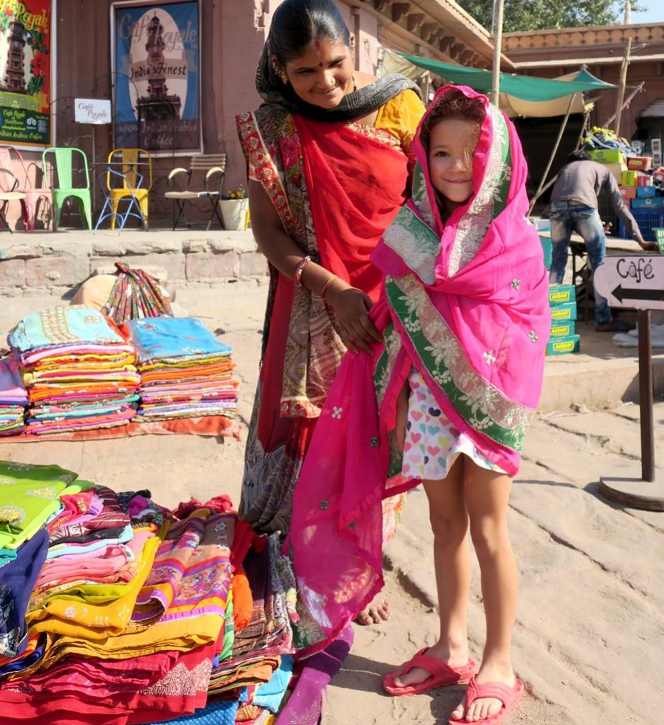 Sari seller in a traditional Rajasthani market