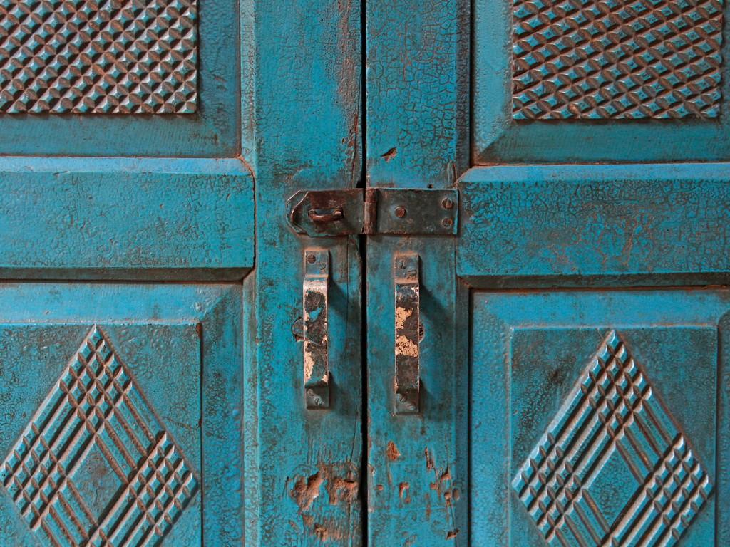 large blue armoire wardrobe