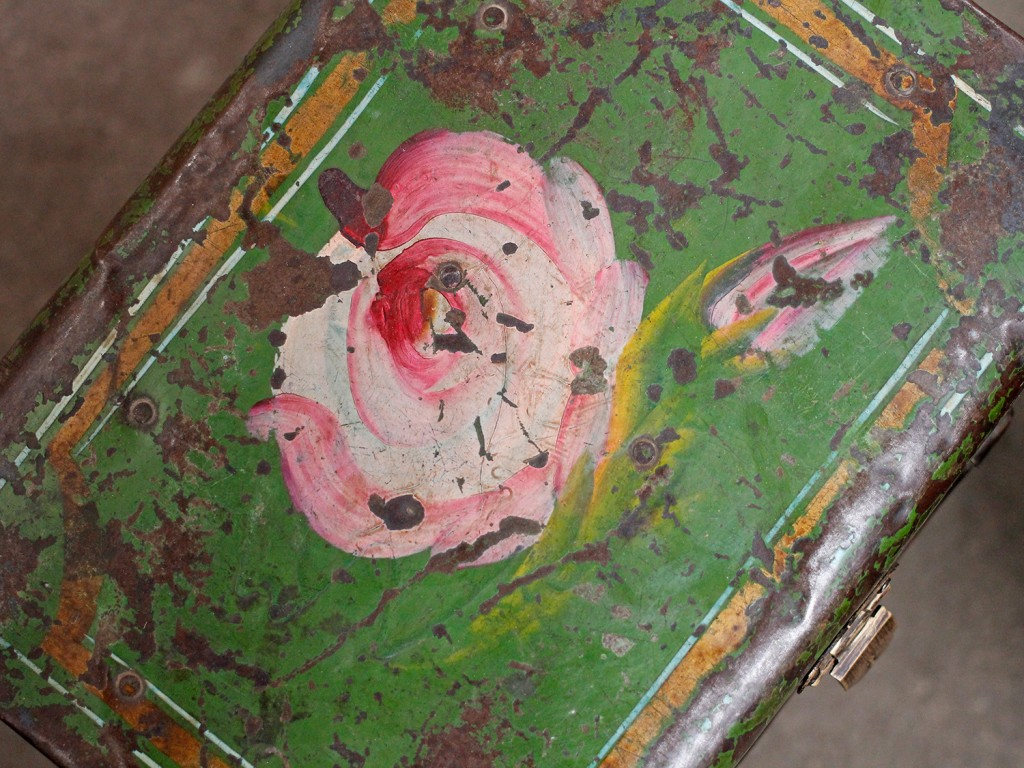 vintage metal suitcase with distressed painted finish