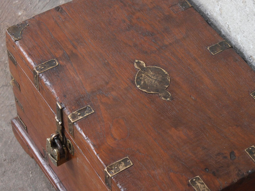 old wooden chest with a deep brown patina