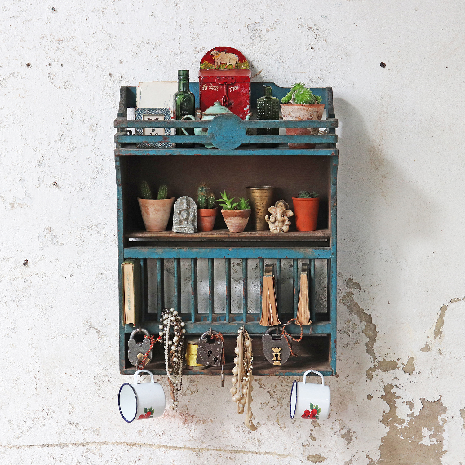 Vintage blue wall rack perfect for Indian summer interiors