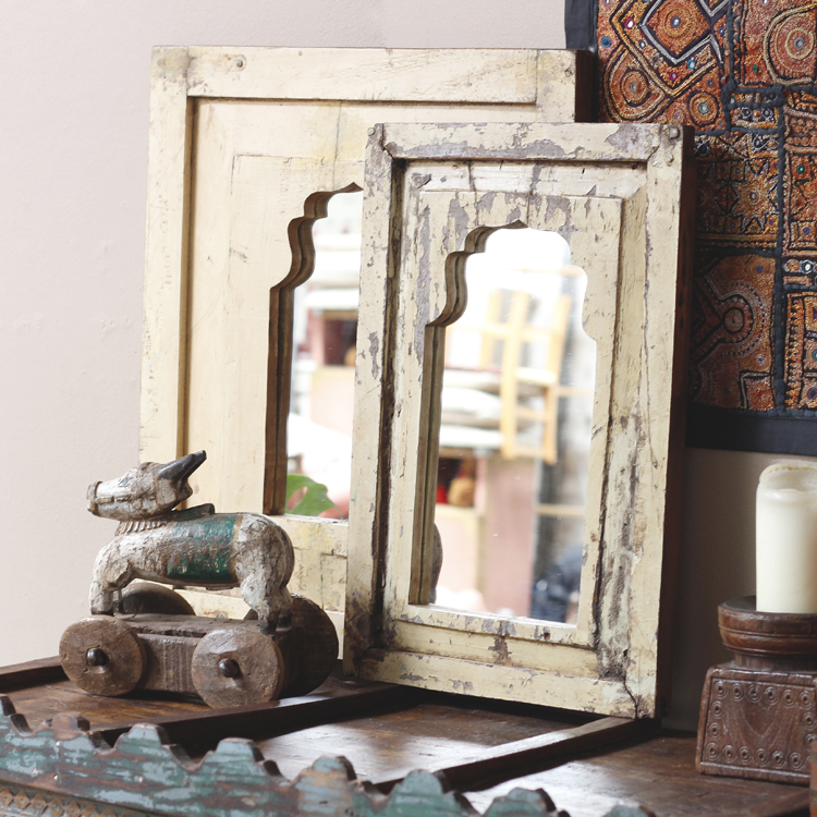 reclaimed door panels repurposed into mirrors