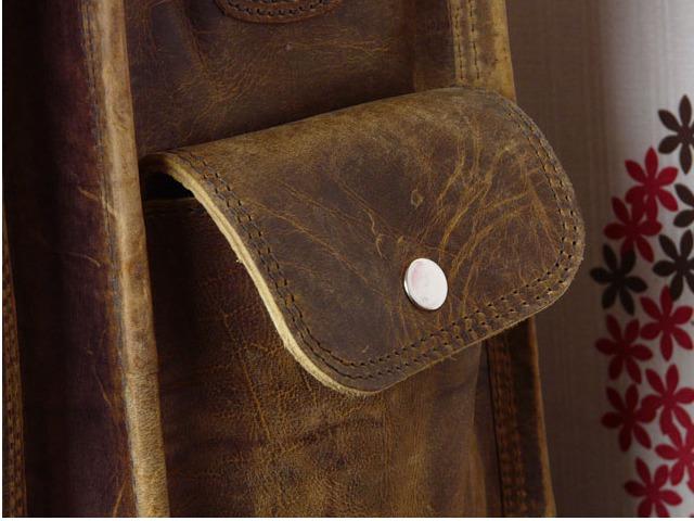 External pocket with popper fastening at Scaramanga