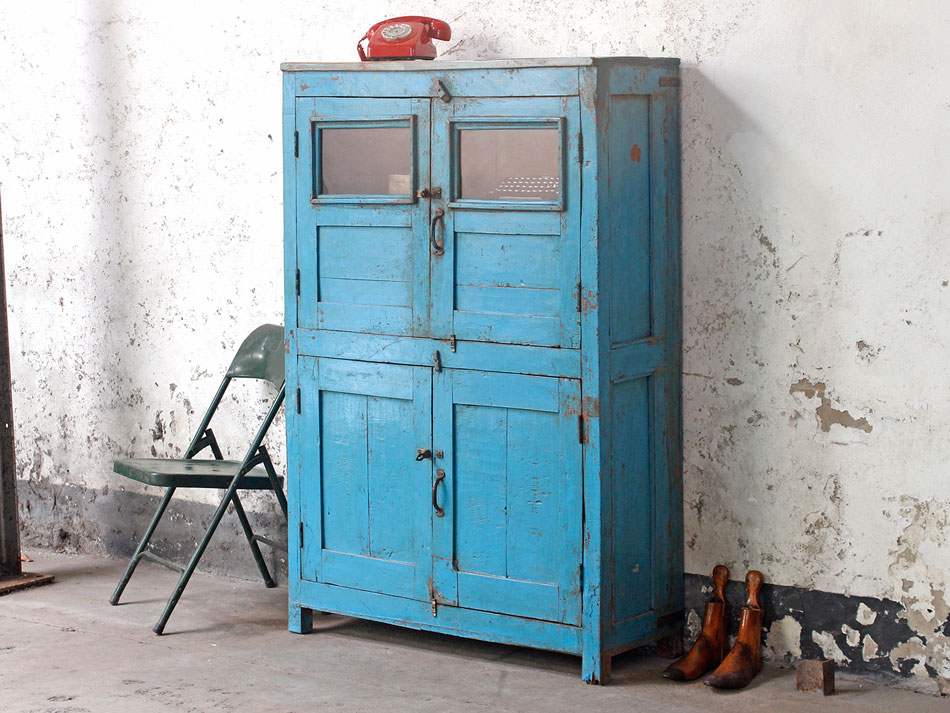 Blue vintage wardrobe used as a kitchen larder