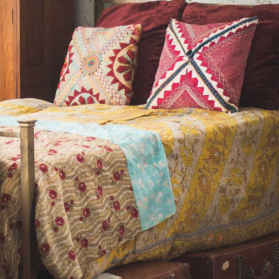 Tropical and vintage kanthas add colour to a colonial styled space