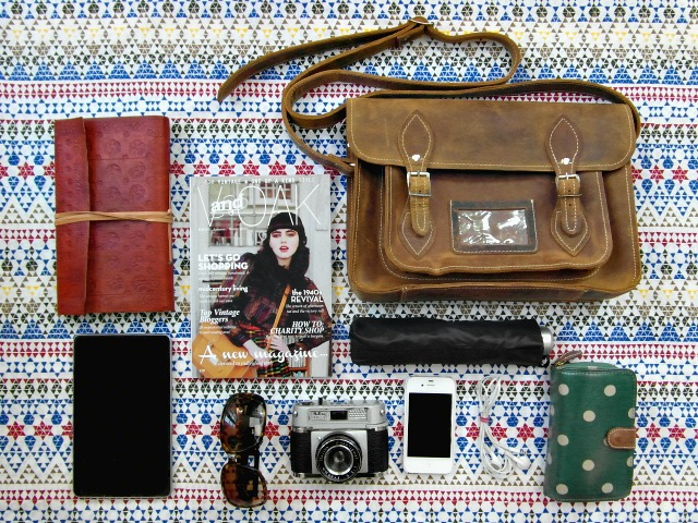 The Scaramanga 13-Inch Leather Satchel and its contents