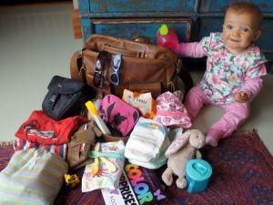 Ella and the contents of mum's stylish Scaramanga baby bag!