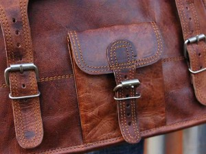 The new small wide leather satchel featuring a front pocket.