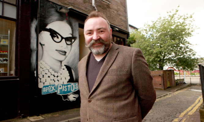 Richard Cook outside Spex Pistols