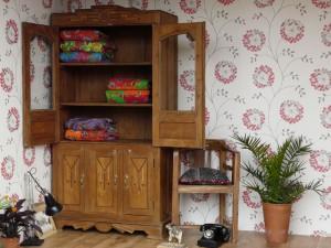 An art deco vintage cupboard - used as a linen cupboard