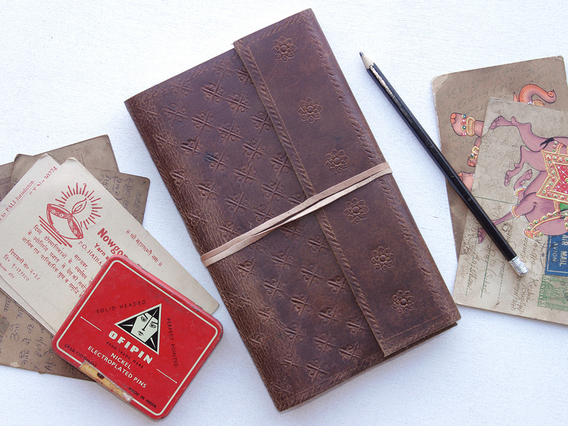 View our  Embossed Large Leather Travel Journal  from the   collection