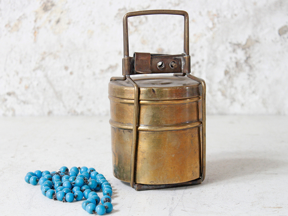 View our  Large Brass Indian Tiffin Tin from the  Old Travel Trunks collection