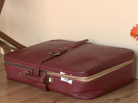 View our  Red Retro Leather Suitcase from the   collection