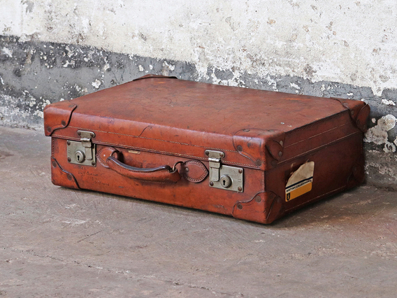 View our  Brown Antique Leather Suitcase from the  Display Cabinets collection