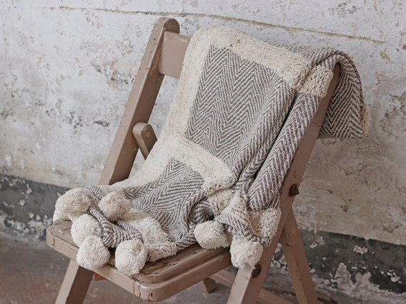 View our  Cotton Throw with Pompons from the  Gifts Under £100 collection