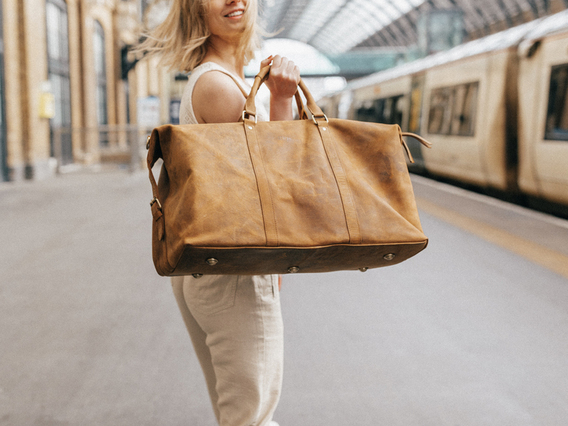 View our Women Leather Duffle Bag from the Women Leather Satchels & Bags collection