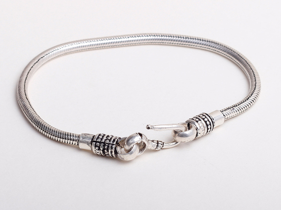 View our  Thick Sterling Silver Bracelet from the   collection