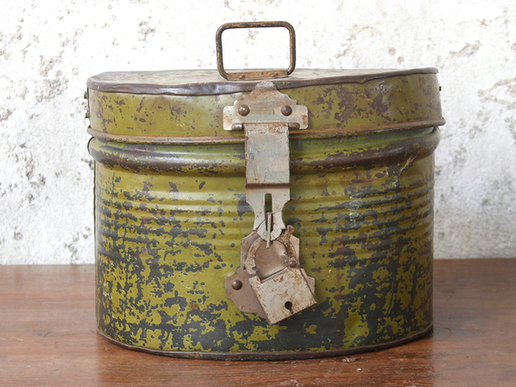 View our  Old Green Metal Hat Box from the   collection