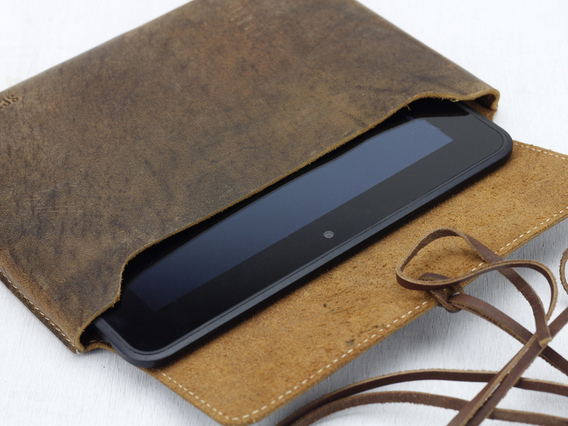 View our  Leather Tablet Case 7 + 8 Inch (String) from the  Travel Accessories collection