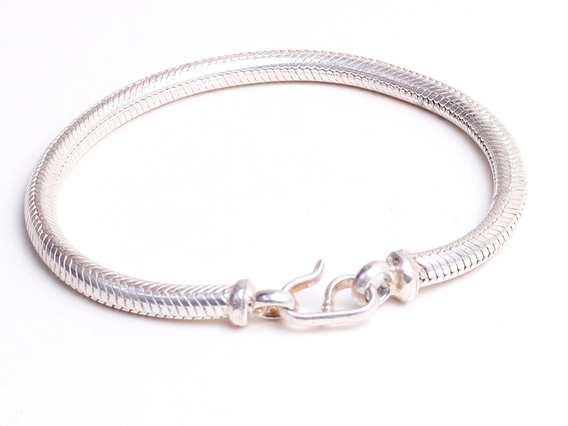 View our  Thick Round Sterling Silver Bracelet from the   collection