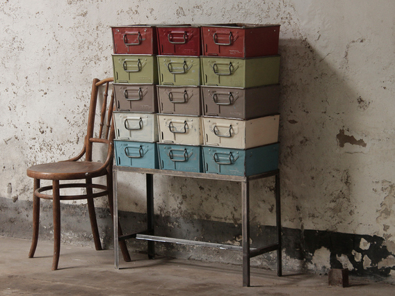 View our  Upcycled Vintage Tote Tin Rack from the  Old Travel Trunks collection