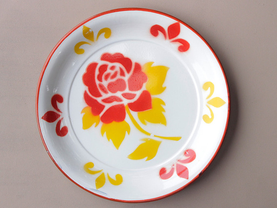 View our  Large Yellow Floral Enamel Plate from the   collection