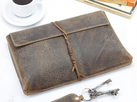 View our  Leather Tablet Case 9 + 10 Inch (String) from the  Travel Essentials collection
