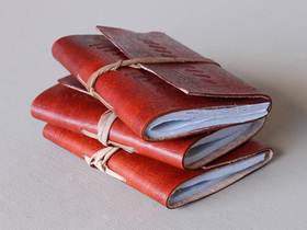 View our  Small Leather Wrap Journal Embossed from the  Leather Journals collection